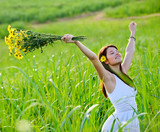 carefree attractive girl in field