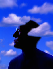 Silhouette Of Man's Head With Cloud Background
