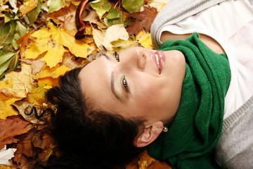 Female lying on the leaves