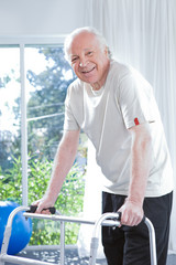 Happy man with a walker