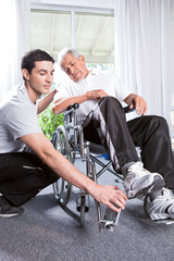 Helping a disabled man to stand up