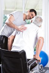 Volunteer helping old man to walk