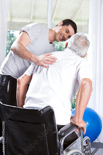 Volunteer helping old man to walk