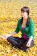 beautiful girl with  yoga in the yellow autumn leaves