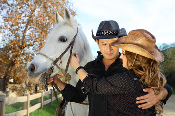Couple in love with a white horse