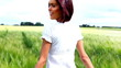 Happy young beautiful woman on cereal field in summer - Outdoor