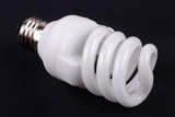 energy saving bulb on black