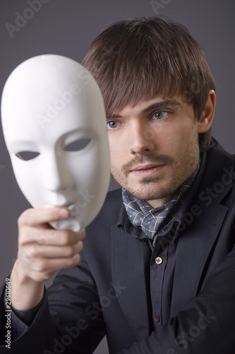man hiding face under white mask