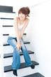 beautiful asian woman sitting on the stair