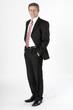 Stehender Geschäftsmann im Anzug