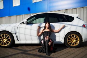 Young woman near white sports car