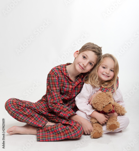 Boy, girl and teddy bear