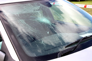 A Broken Car Windscreen at an Accident Site.