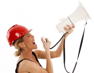 Young woman on a stepladder screaming throug a megaphone