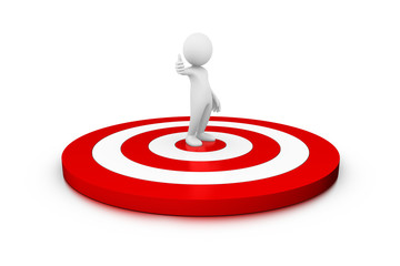 Man standing on a big target wih a winning attitude