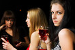 Young women relaxing in a bar