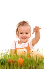 Happy laughing little girl with spring chicks and easter eggs