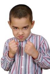 Boy with fists raised ready to fight, isolated