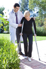 Trying to walk with a doctor's help