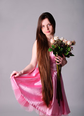 Woman in pink silk dress