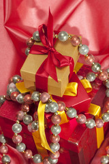Christmas gift boxes over silk background
