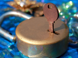 rusted key and golden lock