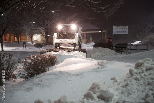 Leinwandbild Motiv bobcat removing snow