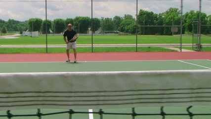 Tennis Player Volleys 04