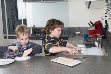 Two boys doing the dishes