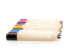 ten colorful pencils abreast isolated over white