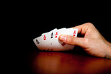Hand revealing four aces poster