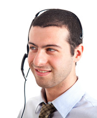 Smiling call center man with headset isolated on white