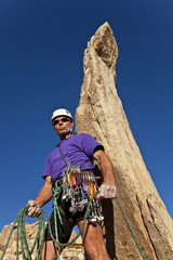 Male rock climber on the summit.