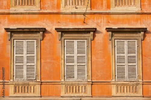 Colorful facade of old Modena building, Italy