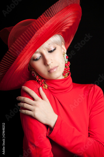 beautiful blonde in a red hat on a black background