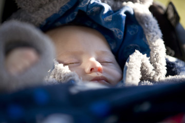 Close-up of a baby sleeping in his buggy