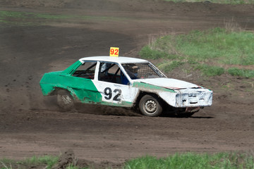 Race for survival. Green white car