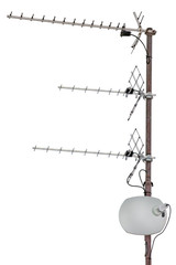 TV and communication aerials on residential house roof, isolated