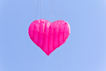 love heart kite against blue sky