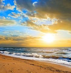 shining sun goes down at sea