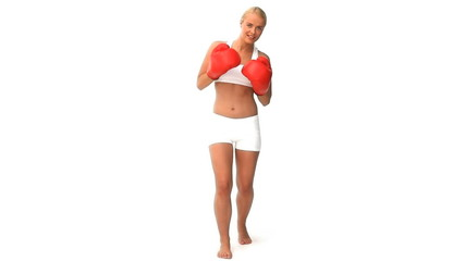 Blond ewoman boxing isolated on a white background
