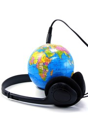 Headphones plugged into a globe - Worldwide music concept