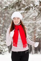 sporty woman runs at winter park