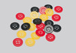 Red Yellow and Black buttons on grey