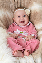 Smiling baby on a beautiful beige background