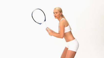 Wonderful blonde woman playing tennis