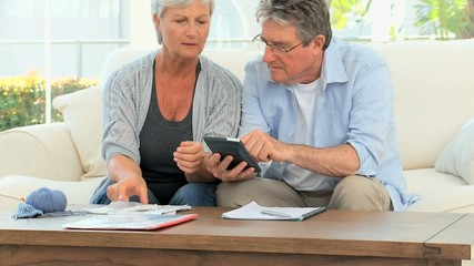 Mature couple calculating their domestic bills