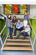 Group of people on stairs in office
