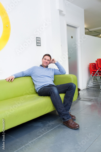 Man sitting on couch in office