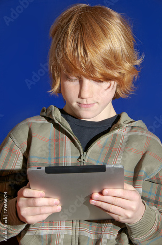 Young boy with a tablet computer